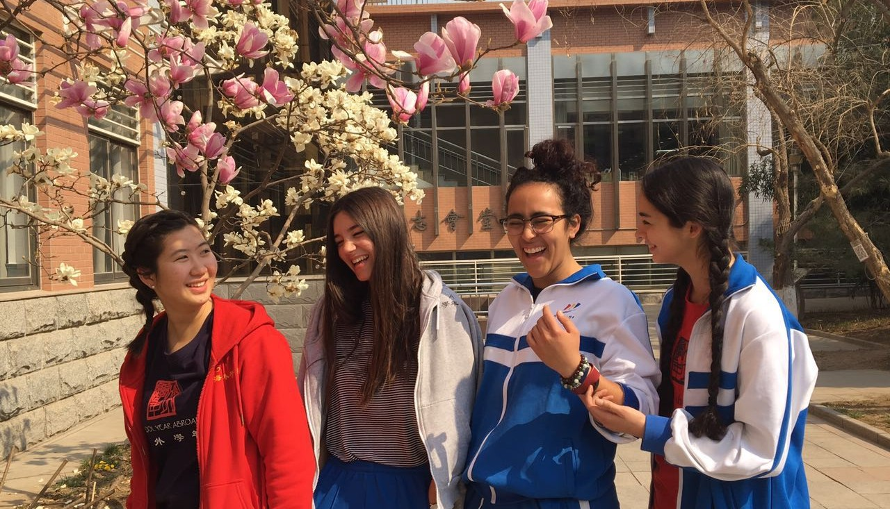 Lena smiles with other SYA China students