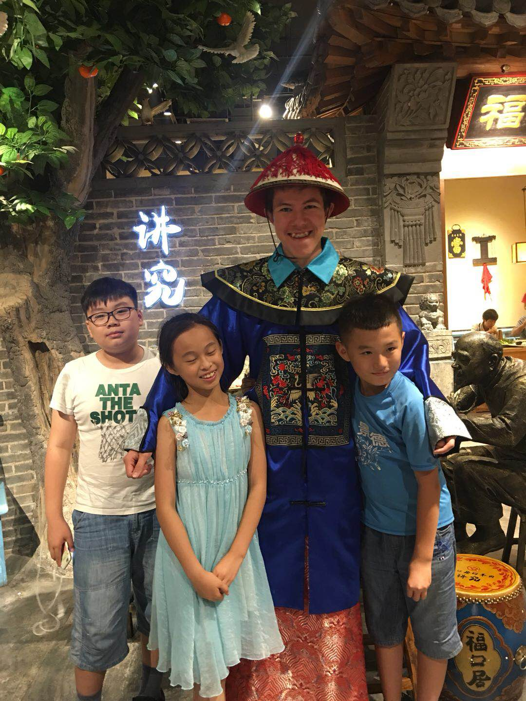 SYA China student dresses up with host family siblings