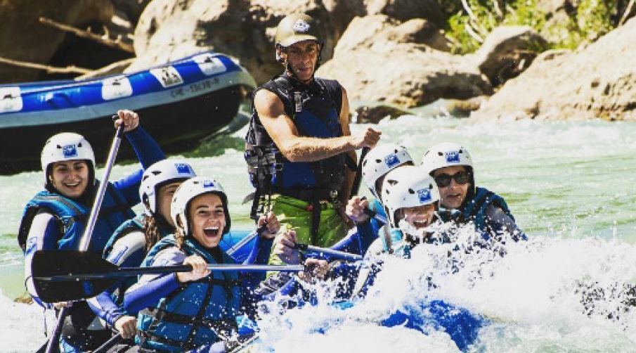 SYA Spain Summer students rafting in water